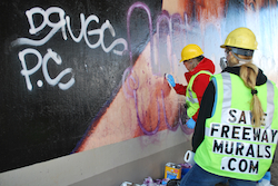 Removing graffiti from a mural