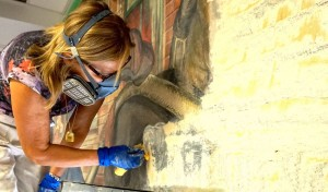 Anna Frassine, Italian Mural Conservator removes the last layer of paint.