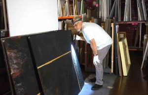 Scott M. Haskins assessing water damage - flaking, blooming, distortions, mold