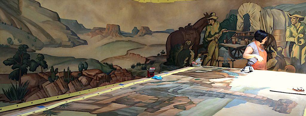 Oriana Montemurro inpainting murals by historic Texas artist, Buck Winn.