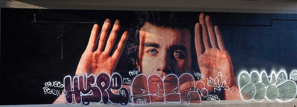 Just cleaned, Jim Morphesis Monument mural with new graffiti