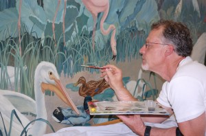 Scott M. Haskins inpainting a mural by Jessie Botke