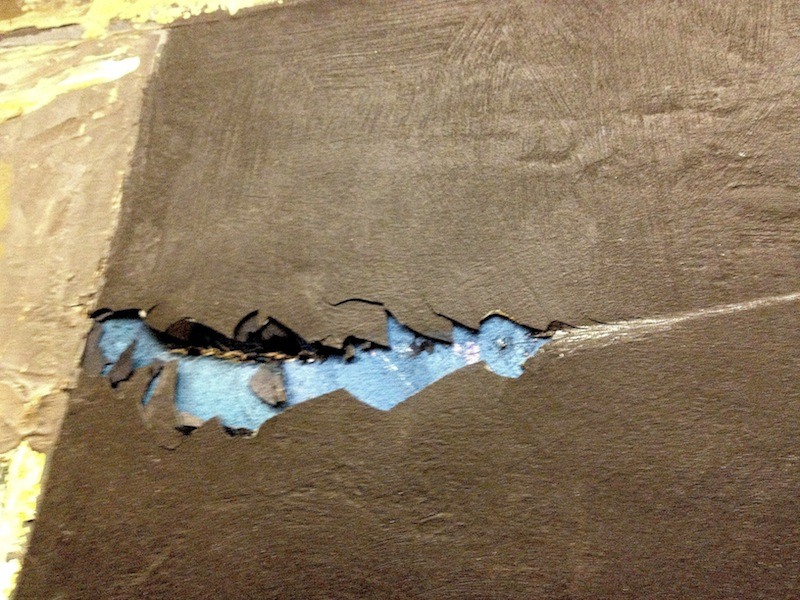 Careless handling damaged this valuable painting - detail of damage