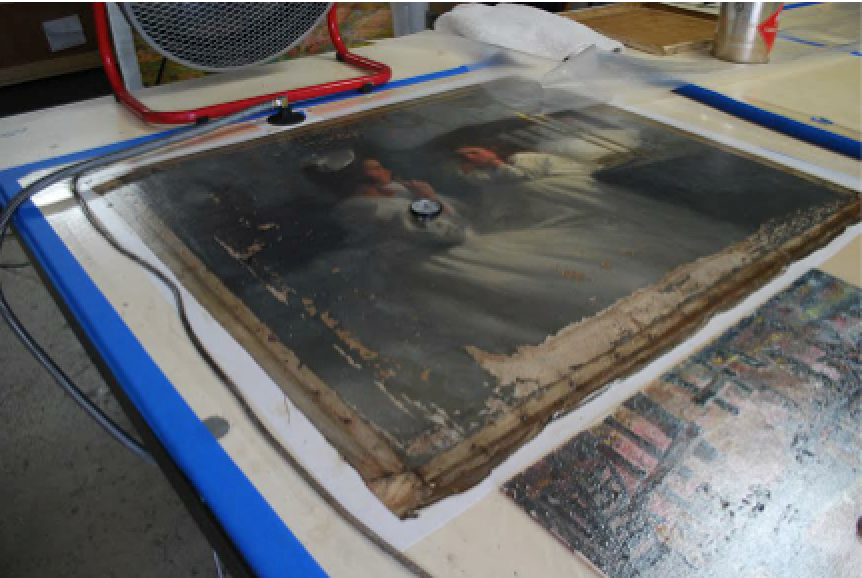 Stopping flaking on a water damaged painting on the hot table